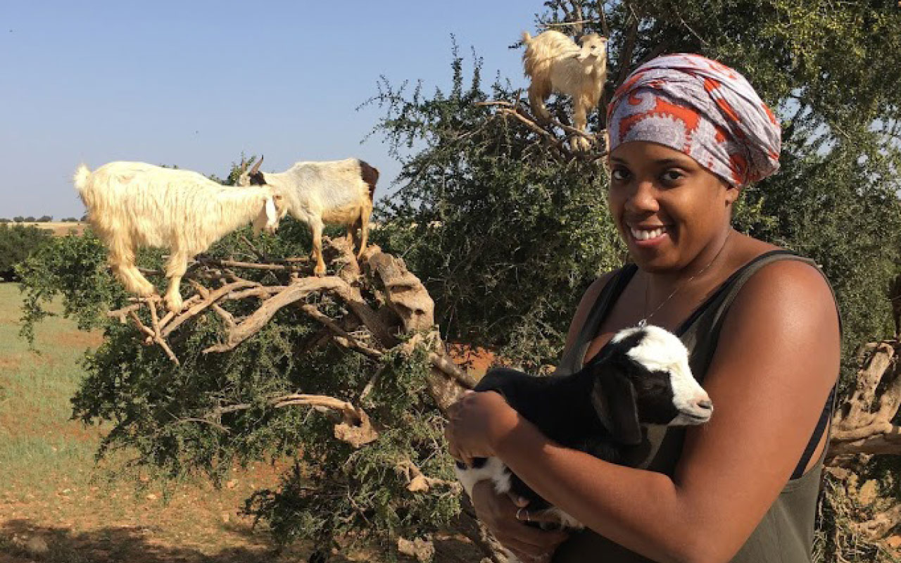 Kernesha Weatherly is pictured with an Agrarian tree goat just outside of Essaouria, Morocco, which she says was the main reason she wanted to visit Morocco.