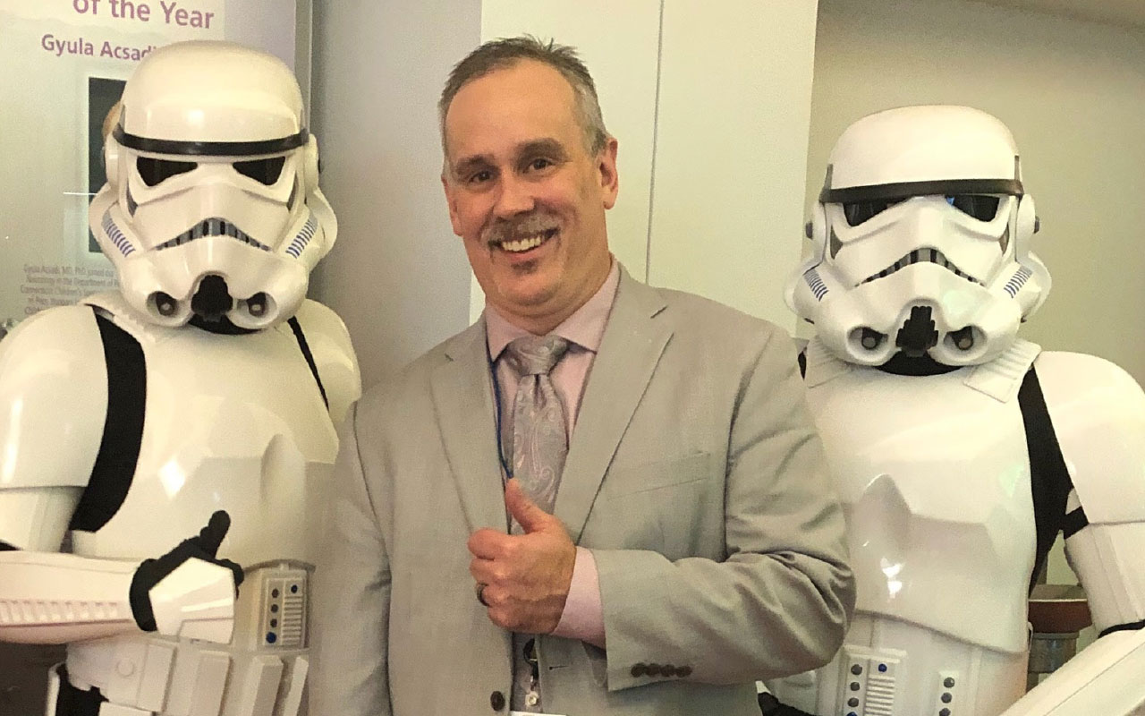 Joe Phillips is seen with Stormtroopers at a conference.